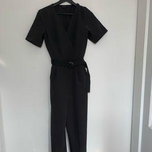 Black jumpsuit with sport belt